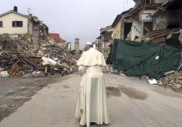 """Pope Francis prays in front of rubble of the quake-struck town of Amatrice, Italy. Francis made a surprise visit Tuesday to the quake zone in central Italy, saying that he wanted """"to be close to the people."""""""