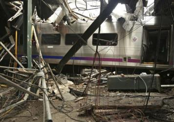 New Jersey's Hoboken Terminal after a commuter train crash that killed one person and injured more than 100 others last week. Preliminary findings gleaned from video and data recorders indicate the train was traveling at twice the 10 mph speed limit just before the collision.