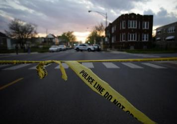 Laquan McDonald, right, walked down the street moments before being fatally shot by a police officer sixteen times in Chicago. The shooting was part of a steady drumbeat of scandals that have embroiled the city's police department in recent years.