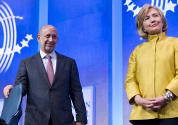 Goldman Sachs Chairman & CEO Lloyd Blankfein stands with Hillary Clinton during the 2014 Clinton Global Initiative meeting in New York on Sept. 24, 2014.