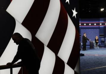 Students stand in on the stage as preparations are made for the second presidential debate at Washington University in St. Louis.