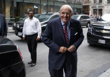 Former New York mayor Rudy Giuliani arrives at Trump Tower Saturday to strategize with Donald Trump over how to handle tapes capturing the GOP nominee making lewd statements about women