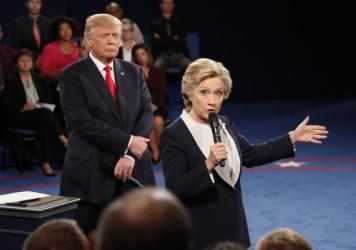 Democratic presidential nominee Hillary Clinton speaks as Republican presidential nominee Donald Trump listens during the second presidential debate at Washington University in St. Louis, on Sunday.