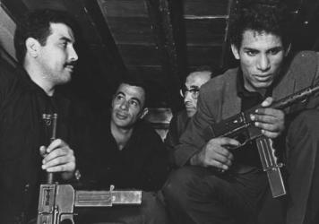 Saadi Yacef, as revolutionary leader El-hadi Jaffar (second from left) and Brahim Haggiag (right) as revolutionary leader Ali La Pointe in a scene from Gillo Pontecorvo's <em>The Battle Of Algiers</em>.