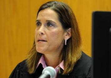 Congress has broadly prohibited lawsuits against gun-makers for harm caused by their weapons, Superior Court Judge Barbara Bellis ruled Friday. The judge is seen here during a hearing in Bridgeport, Conn., in June.