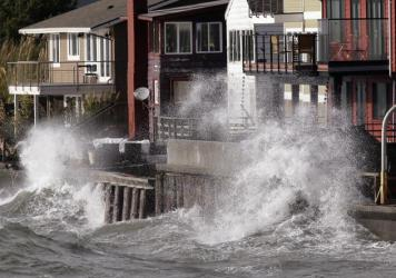 Waves batter a seawall on Friday in Seattle. The remnants of a typhoon brought rain and wind to the Pacific Northwest on Friday and Saturday.