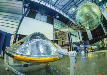 A full-size model of the ExoMars entry, descent and landing module Schiaparelli, with its parachute deployed, was on display in the Netherlands in April. The actual lander is en route to the surface of Mars and set to arrive on Wednesday.