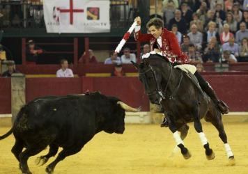 Spanish rejoneador Pablo Hermoso de Mendoza brandishes a banderilla as he fights a bull during the El Pilar Feria at La Misericordia bullring last week.