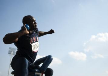 Dennis Ogbe practiced by throwing rocks and auto parts — and now is a world-class shot-putter among athletes with disabilities. Above, he competes in the Parapan American Games.