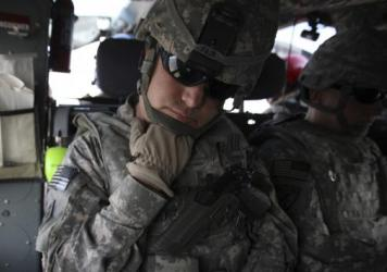 The Pentagon is seeking millions of dollars from nearly 10,000 current or former soldiers in the California National Guard, saying they didn't deserve reenlistment bonuses. Here, soldiers from the state's Guard force are seen in 2010, resting during tran