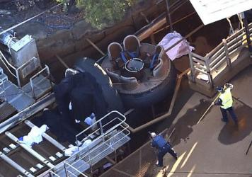 Emergency services personnel are seen at the Thunder River Rapids ride at Dreamworld south of Brisbane in Queensland, Australia, on Tuesday. Four people died after a malfunction caused two people to be ejected from their raft, while two others were caught inside the ride at the popular Gold Coast theme park.