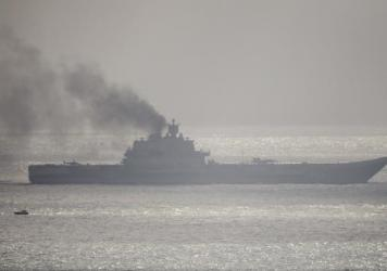 The Russian aircraft carrier Admiral Kuznetsov passed through the English Channel near Dover, England, on Friday. Several warships traveling with the aircraft carrier were planning to refuel at the Spanish port of Ceuta, but Russia has withdrawn its refueling request.
