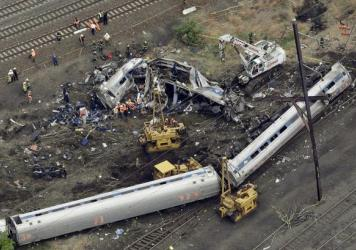 Emergency personnel work at the scene of a derailment in Philadelphia of the Amtrak train headed to New York in May 2015.