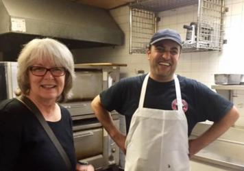 Marsha Lewis, a semi-retired teacher, is one of the volunteers helping Syrian refugee Fadi al-Asmi, standing in the kitchen of Hartford's City Steam Brewery. Asmi, who co-owned a pastry shop in Damascus, now makes desserts at this Hartford cafe.