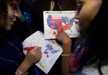 Rakeda Leaks (right) and Candice Williams fill out Electoral College maps on election night 2008.
