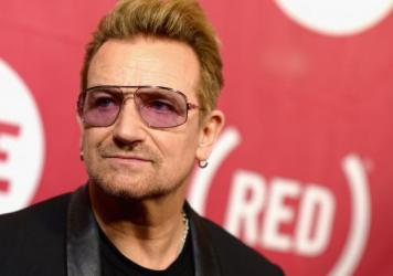 Singer and activist Bono attends a concert to mark World AIDS Day at New York City's Carnegie Hall in December 2015. This year, <em>Glamour</em> named him as one of the magazine's Women of the Year honorees, the first man to receive the award.