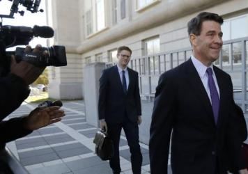 Bill Baroni (right), New Jersey Gov. Chris Christie's former top appointee at the Port Authority of New York and New Jersey, arrives at federal court in Newark, N.J., on Friday. Baroni and Bridget Kelly were found guilty of scheming to use traffic jams to punish a Democratic mayor who didn't endorse Christie in 2013.