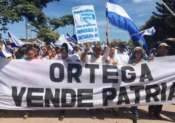 "Thousands of Nicaraguans protested last weekend against Daniel Ortega, who is running for a third term as president in Sunday's election. Critics say he has effectively eliminated all serious opposition. The banner reads, ""Ortega Sells the Homeland."""