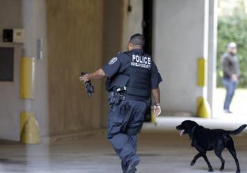 An officer with the Department of Homeland Security patrols outside the federal courthouse in Charleston, S.C., on Monday.
