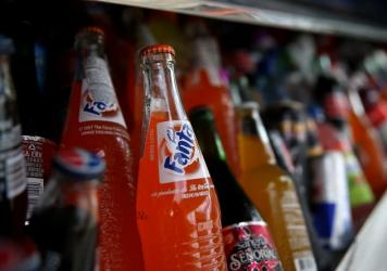 Bottles of Fanta are displayed in a food truck's cooler in San Francisco, Calif. The city is one of three in California, and four in the U.S., that passed taxes on sodas and other sugary drinks in Tuesday's election.