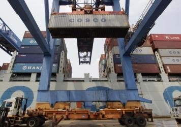 A container ship from China is offloaded at Massport's Conley Terminal in the port of Boston.