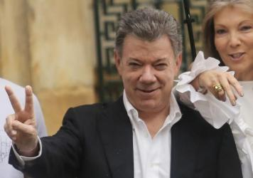 Colombian President Juan Manuel Santos makes a peace sign with wife Maria Clemencia Rodriguez after voting in the October referendum. That deal was rejected by voters; both sides hope the new, amended version will find success.