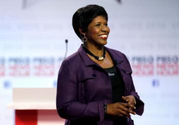 Gwen Ifill takes the stage before moderating a Democratic presidential primary debate at the University of Wisconsin, Milwaukee in February.