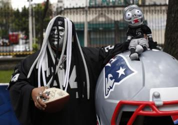 An Oakland Raiders fan poses at the NFL Fan Fest inside the Chapultepec Park in Mexico City. The Oakland Raiders beat the Houston Texans, 27-20, at a sold-out Mexico City Azteca Stadium on Monday.