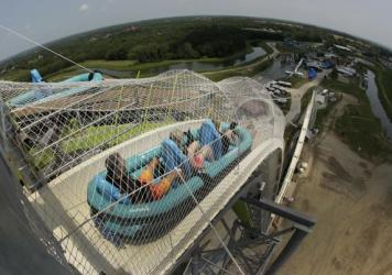 "In this photo taken with a fisheye lens, riders go down the world's tallest water slide called ""Verruckt"" at Schlitterbahn Waterpark in 2014."