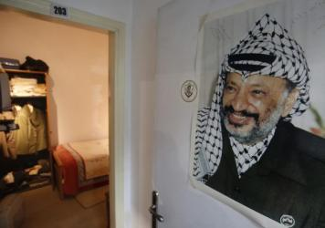Personal items that belonged to Yasser Arafat, including his pistol and keffiyeh, are displayed in the museum.
