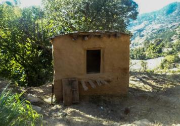 Dambara Upadhyay died alone inside this shelter. She was following the practice of menstrual exclusion that's common in parts of western Nepal: sleeping outside the home during menstruation.