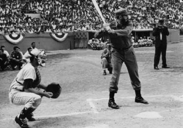 Cuban revolutionary leader Fidel Castro playing baseball.