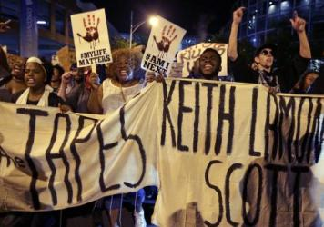"People march in Charlotte, N.C., on Sept. 23 to protest the fatal police shooting of Keith Lamont Scott. The Mecklenburg County district attorney said Wednesday he was ""entirely convinced"" that the officer who shot Scott ""was lawful in using deadly force"
