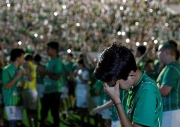 Some coffins for players of the Brazilian football team Chapecoense Real sit at a mortuary in Medellín, Colombia, on Wednesday. Investigators worked Thursday to finish identifying 71 victims of the plane crash as members of the public were left reeling