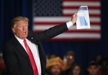 Donald Trump clearly knows the manufacturing numbers; here, he shows a graph on manufacturing while speaking during an April campaign event in Wisconsin.