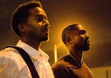 Kevin (Andre Holland, L) and Chiron (Trevante Rhodes, R) walk through the longest parking lot in the world in <em>Moonlight</em>.