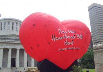A large balloon in support of the Heartbeat Bill flies outside the Statehouse in Columbus, Ohio, in June 2012. More than four years later, the measure, which would ban abortions as soon as six weeks after conception, has passed the Legislature — after