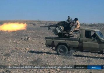 An image posted online Saturday by supporters of the ISIS militant group purports to show a gun-mounted vehicle operated by the group firing at Syrian troops north of Palmyra in Homs Provence, Syria.