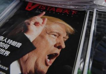 "A magazine featuring U.S. President-elect Donald Trump is seen at a bookstore in Beijing on Monday. The headline reads, ""How will businessman Trump change the world?"" Beijing is ""seriously concerned"" by Trump's suggestion that he could drop Washington's"