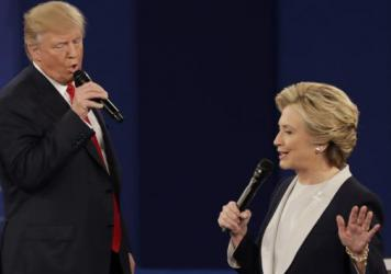 Republican presidential nominee Donald Trump and Democratic presidential nominee Hillary Clinton speak during the second presidential debate at Washington University in St. Louis on Oct. 9.