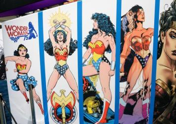 """As of Friday, Wonder Woman will no longer be an honorary U.N. ambassador. A petition protesting her appointment called her """"a large-breasted, white woman of impossible proportions."""" Above, a display at Comic-Con International 2016 shows the evolution of her costume."""