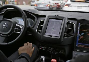 On Tuesday, an Uber driverless car waits in traffic during a test drive in San Francisco. The ride-hailing company is refusing to obey demands by the state's Department of Motor Vehicles that it stop picking up San Francisco passengers in specially equipped Volvo SUVs.