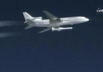 A Pegasus rocket containing eight mini-satellites is air-launched on Thursday.