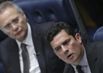 Brazilian Federal Judge Sergio Moro (right) is leading his country's corruption probe of state-run oil company Petrobras. Two Brazilian companies have agreed to more than $3.5 billion in fines for violating U.S. bribery laws in their dealings with Petrob