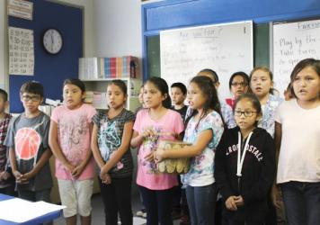 Navajo students at Crystal Boarding School in New Mexico sing traditional songs in class.