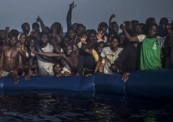 More than 5,000 migrants are reported to have drown while crossing the Mediterranean to Europe this year. Conflict in Libya, flimsier craft, and weather are cited as factors for a rise in deaths from sea crossings.