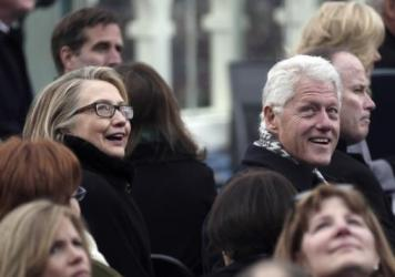 Then-Secretary of State Hillary Rodham Clinton and former president Bill Clinton attend Barack Obama's second inauguration in 2013.