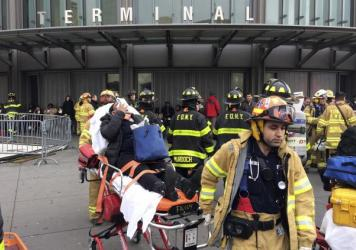 An injured passenger is taken from the Atlantic Terminal in Brooklyn on Wednesday after a Long Island Rail Road train hit a bumping block.