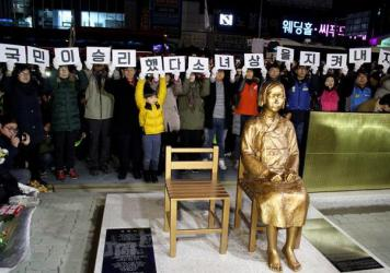 "A statue of a girl symbolizing Korean ""comfort women"" is unveiled last week during a ceremony in front of the Japanese Consulate in Busan, South Korea."