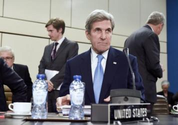 Secretary of State John Kerry attends a meeting of foreign ministers at the NATO headquarters in Brussels on Dec. 6. On Monday, Kerry issued an apology for the State Department's historical mistreatment of LGBT people.
